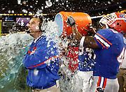 Florida Siler LB Brandon Siler dumps the Gatorade bucket on head coach Urban Meyer during the SEC Championship game between the Arkansas Razorbacks and the Florida Gators at the Georgia Dome in Atlanta, GA on December 2, 2006.<br />