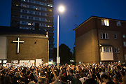 People gather for a two-minute silence for the victims of Grenfell Tower on the 16th June 2017 in North Kensington, London, United Kingdom. The Grenfell Tower fire occurred on 14th June 2017 at the 24-storey block of public housing flats in North Kensington, West London. It caused at least 80 deaths and over 70 injuries, yet the actual numbers have yet to be confirmed