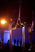 New York, NY - December 17, 2015: Aerialists performing above the dance floor at the Mediacom holiday party at E-Space on the West Side.<br /> <br /> CREDIT: Clay Williams for Mediacom.<br /> <br /> © Clay Williams / claywilliamsphoto.com