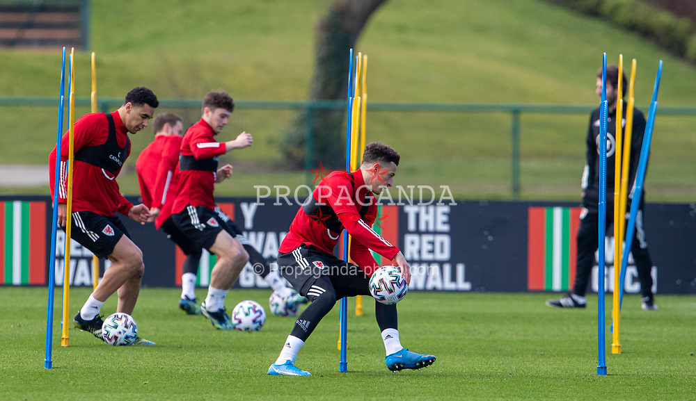 CARDIFF, WALES - Tuesday, March 23, 2021: Wales' Ethan Ampadu (R) during a training session at the Vale Resort ahead of the FIFA World Cup Qatar 2022 Qualifying game against Belgium. (Pic by David Rawcliffe/Propaganda)