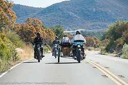 Dawn and Doc Hopkins ride their 1915 Harley-Davidson past Shinya Kimura on his Team-80 1915 Indian twin during the Motorcycle Cannonball Race of the Century. Stage-15 ride from Palm Desert, CA to Carlsbad, CA. USA. Sunday September 25, 2016. Photography ©2016 Michael Lichter.