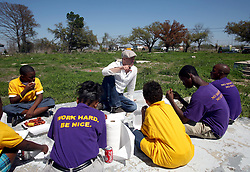 16 March 2008. New Orleans, Louisiana. Lower 9th ward.<br /> Movie star Brad Pitt talks with students and some of the former residents for the 'Make a Difference, Make a Commitment' clean up of the neighbourhood devastated by Hurricane Katrina. The massive clean up project was organised by Brad Pitt's Make it Right Foundation aided by the Clinton Global Initiative.<br /> Photo credit; Charlie Varley.