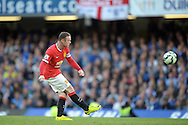 Wayne Rooney, the Manchester United captain crossing the ball. Barclays Premier league match, Chelsea v Manchester Utd at Stamford Bridge Stadium in London on Saturday 18th April 2015.<br /> pic by John Patrick Fletcher, Andrew Orchard sports photography.