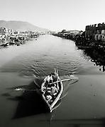 Small rowing boat moving down a river at Cap-Haïtien, Haiti