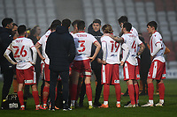 Football - 2020 / 2021 Emirates FA Cup - Round 2 - Stevenage vs Hull City - Lamex Stadium<br /> <br /> Stevenage manager Alex Revell with his players before the penalty shoot out.<br /> <br /> COLORSPORT/ASHLEY WESTERN