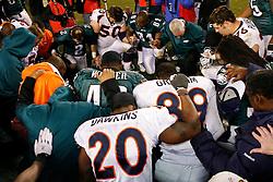 Philadelphia Eagles and Denver Broncos come toghether to pray after the NFL game between the Denver Broncos and the Philadelphia Eagles on December 27th 2009. The Eagles won 30-27 at Lincoln Financial Field in Philadelphia, Pennsylvania. (Photo By Brian Garfinkel)