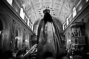 """Virgin Mary statue inside the church.In Ponticelli, the eastern outskirts of Naples, for 250 years, the 5th of August is celebrated the Mother of God with the title of """"Our Lady of the Snows.""""<br /> The statue of the patron is hoisted on top of the """"Wagon"""", the heavy machinery of the party of about 17 meters, carried by hand from less than a hundred men, along the streets of the neighborhood.<br /> The Virgin is enthroned above.<br /> In Via San Rocco the people, without effort, tap the wagon from the balconies, covering it sometimes with confetti.<br /> In Naples, in the places where degradation of culture and traditions are still popular, people condense in the briefest of moments, cyclical, of the party, its history daily, made of sweat, hopes, disappointments, fatigue, illness. The party therefore assumes a character of inevitability for its ability to signify all the painful complexity of life."""
