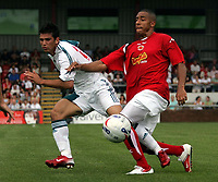 Photo: Paul Thomas.<br /> Crewe Alexandra v Liverpool. Pre Season Friendly. 22/07/2006.<br /> <br /> Liverpool's Mark Gonzalez (L) gets tackled by Jon Otsemobor.