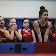 Young gymnasts react to competition on the vault during the 21st American Invitational 2014 competition at the XL Centre. Hartford, Connecticut, USA. USA. 31st January 2014. Photo Tim Clayton