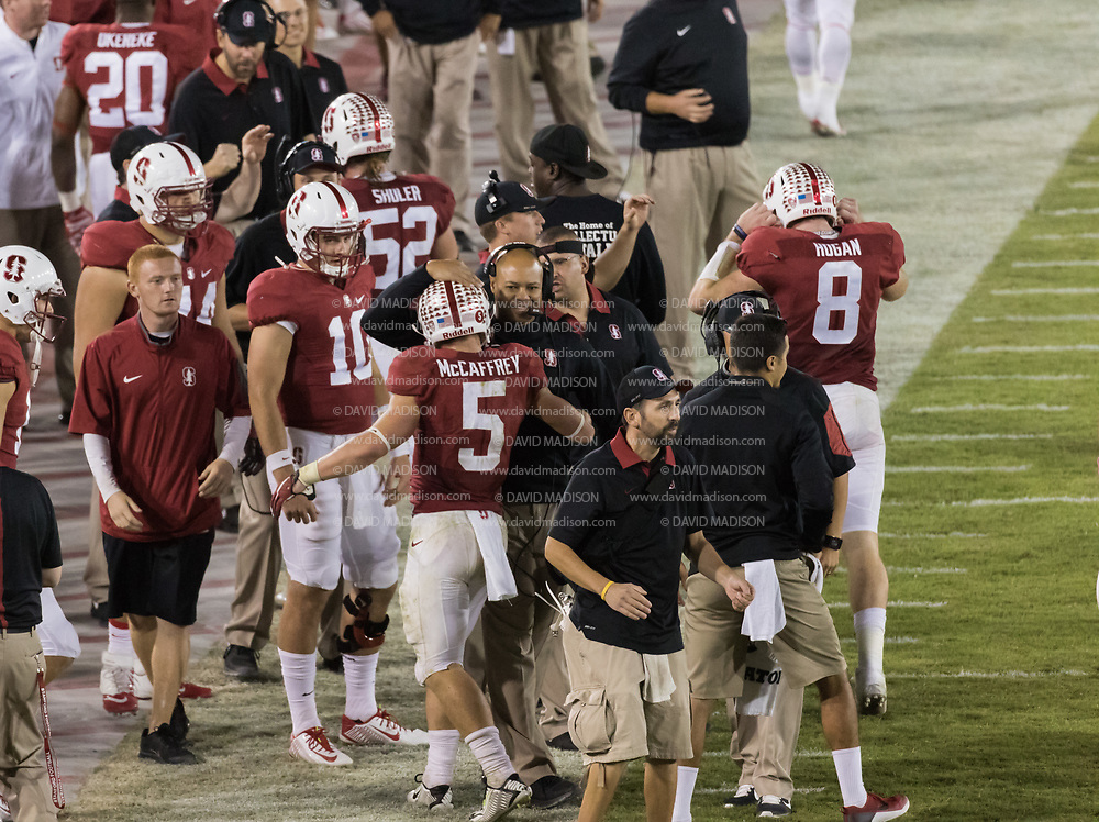 PALO ALTO, CA - OCTOBER 24:  Christian McCaffrey #5 of the Stanford Cardinal is congratulated by head coach David Shaw after scoring a touchdown during a PAC-12 football game against the University of Washington Huskies played on October 24, 2015 at Stanford Stadium on the campus of Stanford University in Palo Alto, California.  Other visible players include #10 Keller Chryst and #8 Kevin Hogan.    (Photo by David Madison/Getty Images) *** Local Caption *** Christian McCaffrey;David Shaw