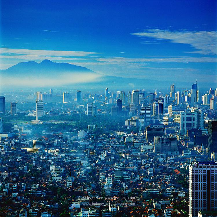 Jakarta City Building with Mount Gede-Pangrango, Jakarta, Java, Indonesia.