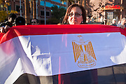 31 JANUARY 2011 - TEMPE, AZ: A woman carries an Egyptian flag through Tempe, AZ, Monday. About 200 people marched through central Tempe, AZ, near the Arizona State University campus Monday afternoon. The rally was organized by the Arab American Association of Arizona in solidarity with the ongoing pro-democracy rallies and demonstrations in Egypt and other Arab countries.    Photo by Jack Kurtz