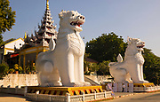 The huge sculptures of Chinthe, or lions, stand at the entrance to Kusinara Ingyin Tawya Pagoda complex, Mandalay Hill, Myanmar