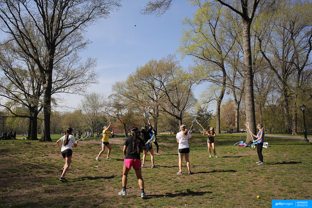 Lacrosse training during a warm spring day in Central Park, Manhattan, New York, USA. Photo Tim Clayton