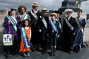 March 4th 2017. Thousands of people, mostly women and girls, marched across Tower Bridge in an event organised by Care International to mark International Womens Day March 8th and the need for gender equality. A group wear suffragette sashes and costumes to mark the contribution of the Suffragettes to the emancipation of women, notably getting the vote.