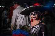 New York, NY - 31 October 2019. the annual Greenwich Village Halloween Parade along Manhattan's 6th Avenue. A woman elaborately costumed as a calavera catrina.
