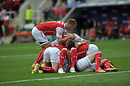 Ryan Hall of Rotherham United is mobbed after he scores against Wolverhampton Wanderers during the Sky Bet Championship match at the New York Stadium, Rotherham<br /> Picture by Graham Crowther/Focus Images Ltd +44 7763 140036<br /> 16/08/2014