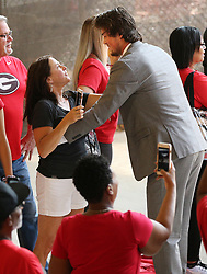 September 2, 2017 - Athens, GA, USA - Georgia quarterback Jacob Eason stops to hug his mother, Christine Eason, while players make the traditional Dawg Walk to the field before playing Appalachian State on Saturday, Sept. 2, 2017, in Athens, Ga. (Credit Image: © Curtis Compton/TNS via ZUMA Wire)