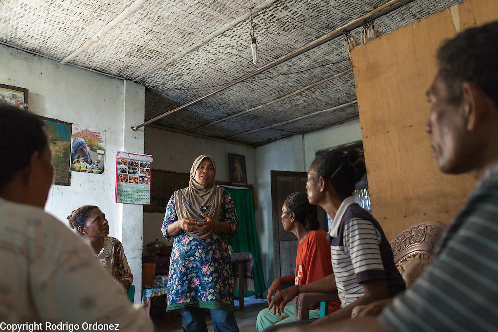 Siti Rofi'ah, 45 (standing), meets with members of a cooperative in Hoelea, Omesuri subdistrict, Lembata district, East Nusa Tenggara province, Indonesia.