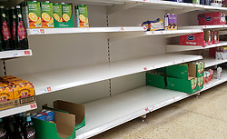 © Licensed to London News Pictures. 09/09/2021. London, UK. Nearly empty shelves of fruit juice in Sainsbury's supermarket in north London. Supermarket bosses warn that prices will rise across the retail industry in the coming months due to coronavirus pandemic disruption and a shortage of HGV drivers. Photo credit: Dinendra Haria/LNP