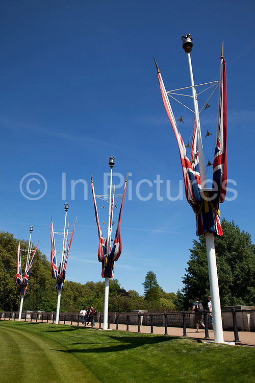 Union Flags also known as the Union Jack, stand on flag poles outside Buckingham Palace.