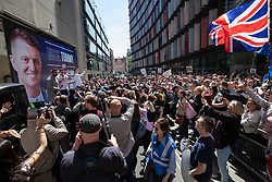 © Licensed to London News Pictures. 14/05/2019. London, UK. Large crows of media and supporters as political activist Stephen Yaxley-Lennon - also known as Tommy Robinson -  arrives at the Old Bailey. Judges are expected to hear an application by the Attorney General for a new case against Yaxley-Lennon, after judges last year overturned a finding against him for contempt of court, after he was accused of filming people in a criminal trial in Leeds and publishing the footage on social media.  Photo credit : Tom Nicholson/LNP