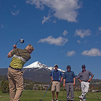Chad Jones tees off at Big Sky Golf Course in Big Sky, Montana while Shane Knowles, Keith Word & Sam Woodger watch.
