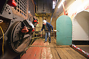 ****COPY HERE****  (https://www.dropbox.com/s/5mg81qiiuy22tre/adamson.rtf?dl=0)   © Licensed to London News Pictures. 02/12/2014. Liverpool , UK .  Volunteer Kev Lytton works on the enormous boiler. The only surviving steam powered tug tender, the Daniel Adamson, is being completely renovated by a team of volunteers in Liverpool. The vessel, which has had 90,000 man hours already spent on it, was bought for only one pound is the awaiting the decision of the Heritage Lottery Fund on an application of £3.6m to bring her back to her full glory.  . Photo credit : Stephen Simpson/LNP<br /> <br /> COPY HERE https://www.dropbox.com/s/5mg81qiiuy22tre/adamson.rtf?dl=0