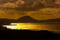 Golden light on Maunalua Bay with Koko Head Crater in background, near Honolulu, Oahu, Hawaii, USA