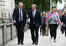 Outgoing Taoiseach Enda Kenny (right) arrives at Government Buildings, Dublin, for his last day as Taoiseach.