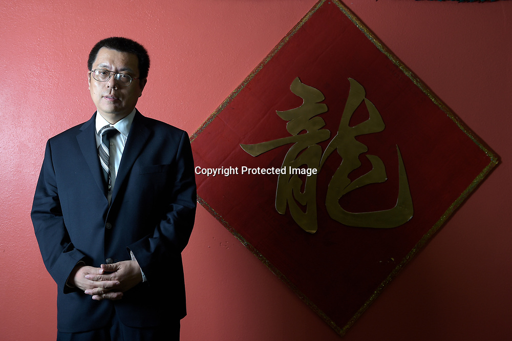 Former University of South Florida professor Dajin Peng poses for a photo at a restaurant near the campus in Tampa, Fla., Friday, Oct. 10, 2014. Peng is on suspension from the university, where he taught international business and directed the Confucius Institute, a cultural program funded by the Chinese government. Peng claims the Federal Bureau of Investigation recruited him to be a spy. (Photo by Phelan M. Ebenhack)