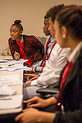 Purchase, NY – 31 October 2014. Early College High School student Jamika Holmes (left) leans in to listen to a point. The Business Skills Olympics was founded by the African American Men of Westchester, is sponsored and facilitated by Morgan Stanley, and is open to high school teams in Westchester County.