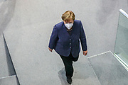 German Chancellor Angela Merkel leaves after an event in which the Secretary General of the United Nations, António Guterres (not pictured), delivered a speech at the lower house of the German Parliament, the Bundestag in Berlin, Germany, December 18, 2020. Guterres was invited as an honorary guest on the occasion of  the founding of the United Nations 75 years ago. <br /> (Photo by Omer Messinger)