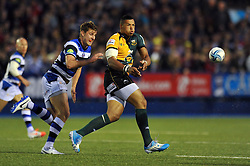 Luther Burrell (Northampton) passes the ball - Photo mandatory by-line: Patrick Khachfe/JMP - Tel: Mobile: 07966 386802 23/05/2014 - SPORT - RUGBY UNION - Cardiff Arms Park, Cardiff - Bath Rugby v Northampton Saints - Amlin Challenge Cup Final.