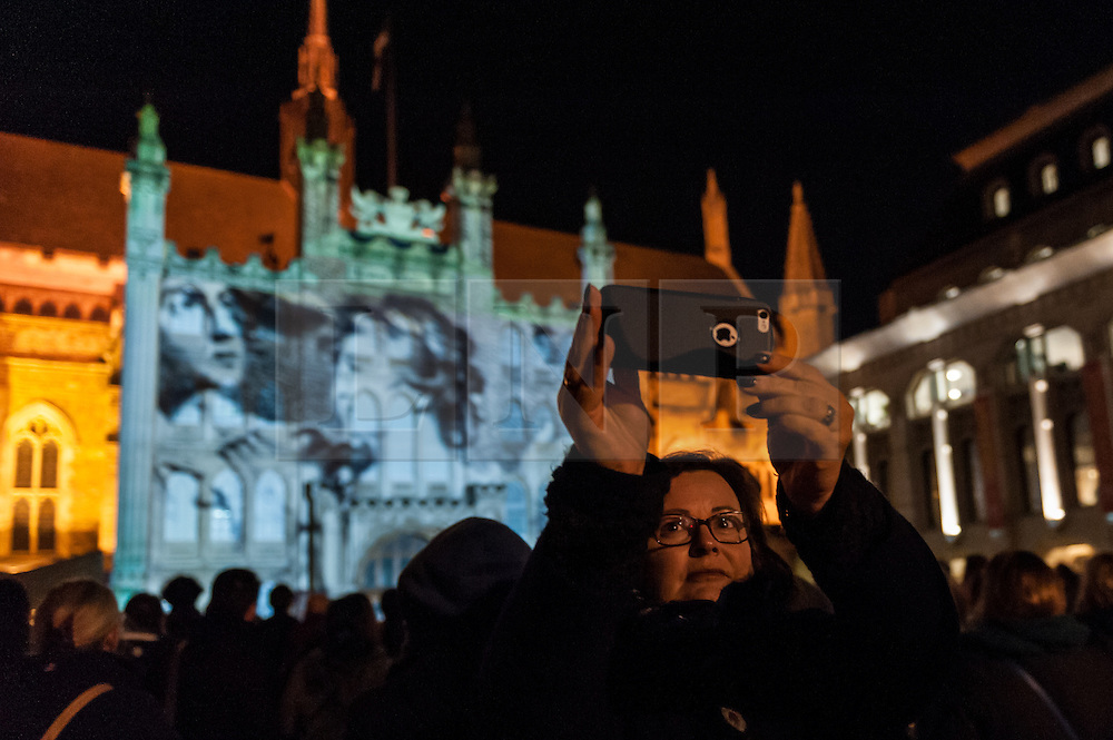 "© Licensed to London News Pictures. 05/03/2016. London, UK. A visitor takes a selfie at the ""Son et Lumière"" at Guildhall.  The spectacular light and sound production celebrates the City's connection to Shakespeare, on the 400th anniversary of his death.  The historic façade of Guildhall is brought to life with 3D projection mapping technology accompanied by a special music composition by the Guildhall School of Music & Drama. Photo credit : Stephen Chung/LNP"