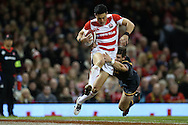 Akihito Yamada of Japan tries to get away from Lloyd Williams of Wales. Under Armour 2016 series international rugby, Wales v Japan at the Principality Stadium in Cardiff , South Wales on Saturday 19th November 2016. pic by Andrew Orchard, Andrew Orchard sports photography