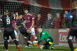 Stenhousemuir's keeper Lewis McMinn saves. Stenhousemuir 1 v 4 Arbroath, Scottish Football League Division One play12/1/2019 at Ochilview Park.