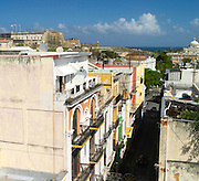 High-angle (roof top) view of Calle Fortaleza, looking eastward, with Castillo de San Cristobal in the background; Old San Juan/Viejo San Juan.
