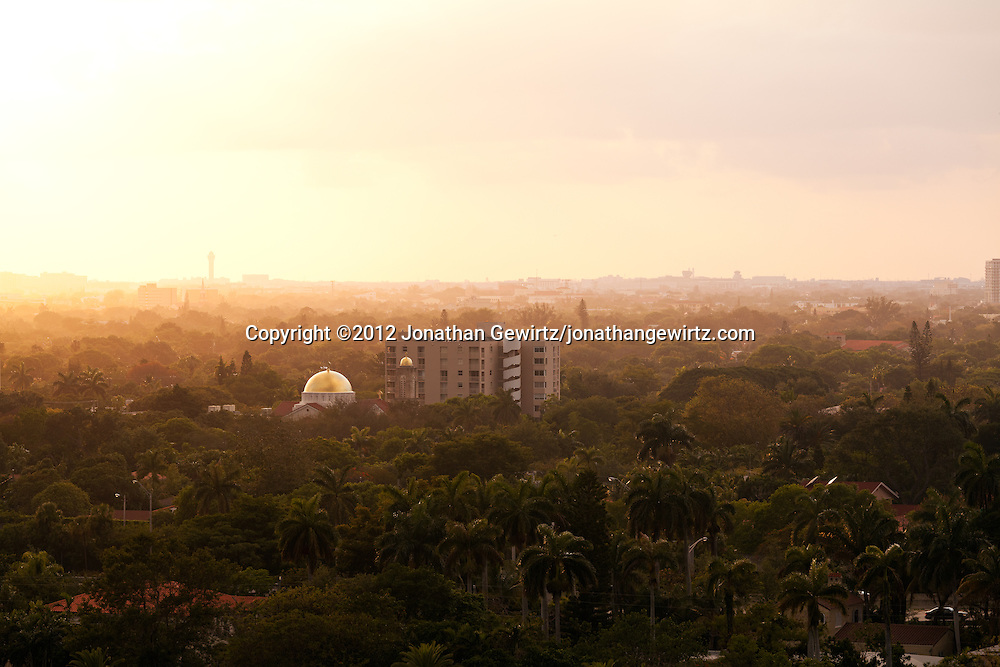 The golden domes of a Greek Orthodox church on Miami's Coral Way reflect the light of the late-afternoon sun. Miami International Airport is visible in the distant background. WATERMARKS WILL NOT APPEAR ON PRINTS OR LICENSED IMAGES.