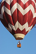 vertical of hot air balloon with two people in basket.