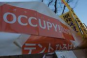 Banners and signs on three tents at an anti-nuclear power demo and occupy Tokyo protest outside the Ministry of the Economy, Trade and Industry (METI) in Tokyo, Japan. Friday 27th January 2012. The protest has been running from September 2011 and was scheduled for forcible eviction by police at 5pm on January 27th as the camp had been declared a fire risk by Minister Yukio Edano, with around 500 supporters and protesters turning up to resist the eviction however the camp was still in place the night of the 27th.