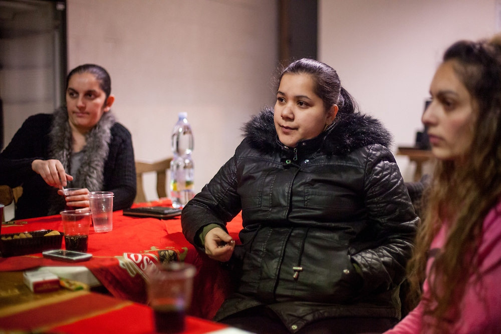 Volunteers Jitka Cervenakova (25, middle, Hana Gaborova on the left and Denisa Gaborova at the right) during a meeting with volunteers for data collection regarding school enrolments in a backroom of a bar in Ostrava.
