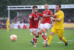 Bobby Reid of Bristol City is closed down by Brislington captain James Peart  - Photo mandatory by-line: Dougie Allward/JMP - Mobile: 07966 386802 - 05/07/2015 - SPORT - Football - Bristol - Brislington Stadium - Pre-Season Friendly