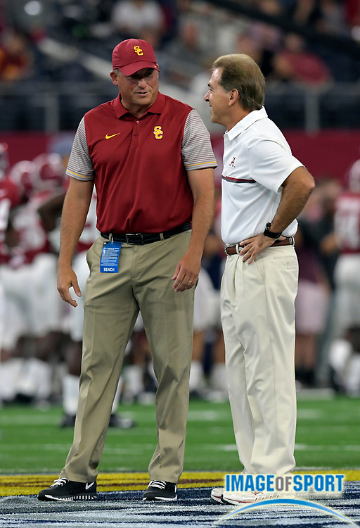 Sep 3, 2016; Arlington, TX, USA; Alabama Crimson Tide head coach Nick Saban (right) shakes hands with USC Trojans head coach Clay Helton before the game at AT&T Stadium.