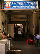 02 FEBRUARY 2013 - PHNOM PENH, CAMBODIA:   A man dozes in a doorway to a local office of the Cambodian People's Party in Phnom Penh. The CPP is the ruling party in Cambodia and follows a socialist platform.      PHOTO BY JACK KURTZ