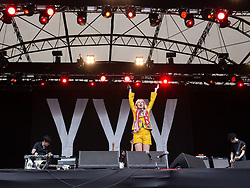 © Licensed to London News Pictures . 20/07/2013 . Suffolk , UK . Karen O (aka Karen Orzolek ) of Yeah Yeah Yeahs on the Obelisk Stage . The Latitude music and culture festival in Henham Park , Southwold . Photo credit : Joel Goodman/LNP