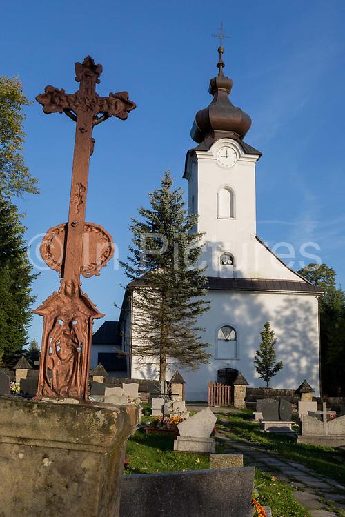 The cemetery and exterior of the Greek-Catholic Jana Chrzciciela church, on 21st September 2019, in Jaworki, near Szczawnica, Malopolska, Poland.
