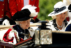 Queen Elizabeth II (left) and the Duchess of Cornwall leave by carriage during the annual Order of the Garter Service at St George's Chapel, Windsor Castle.