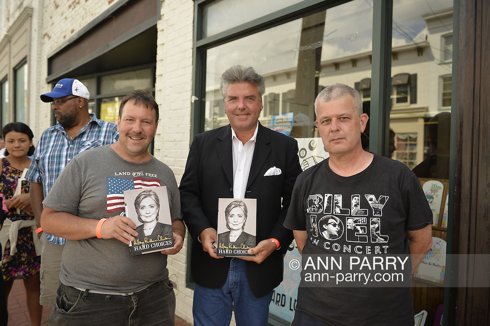 Huntington, New York, U.S. - August 6, 2014 - L - R front, GREG PACKER, of Huntington, CHARLIE PACIULLO, of Coram, and KENNY MITCHELL, of Garden City, are the first three people on line to attend the book signing for H. Clinton's new memoir, Hard Choices, at the Book Revue in Huntington, Long Island. Clinton's book is about her four years as America's 67th Secretary of State and how they influence her view of the future. Packer was waiting since 4 am, and Paciullo since 1 am that day, and Mitchell was waiting since11:10 the night before.