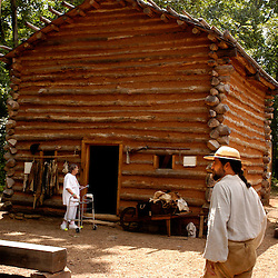 EXPLORE PARK Eddie Goode, right, Explore Park interpeter mans the 1750's Virginian village. Explore Park recreates American life from early native American up until the 19th century.